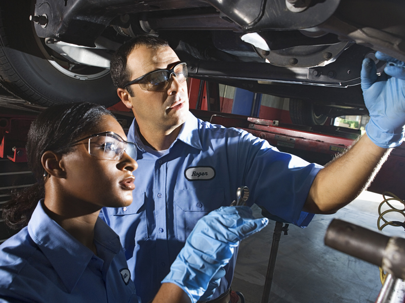 mechanics inspecting vehicle